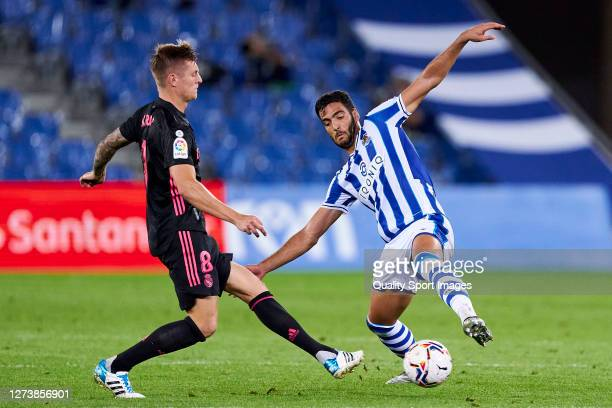 Mikel Merino of Real Sociedad battle for the ball with Toni Kroos of Real Madrid during the La Liga Santader match between Real Sociedad and Real...