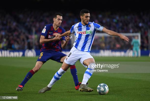 Mikel Merino of Real Sociedad battles for possession with Sergio Busquets of FC Barcelona during the La Liga match between FC Barcelona and Real...