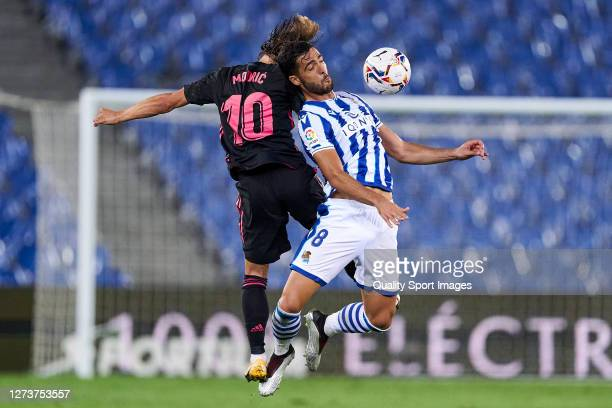Mikel Merino of Real Sociedad battles for the ball with Luka Modric of Real Madrid during the La Liga Santader match between Real Sociedad and Real...