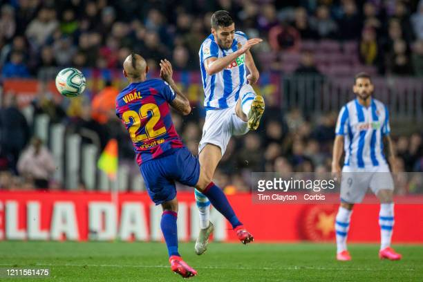 Mikel Merino of Real Sociedad clears while challenged by Arturo Vidal of Barcelona during the Barcelona V Real Sociedad La Liga regular season match...