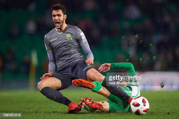 Mikel Merino of Real Sociedad competes for the ball with Giovani Lo Celso of Real Betis Balompie during the Copa del Rey Round of 16 match between...