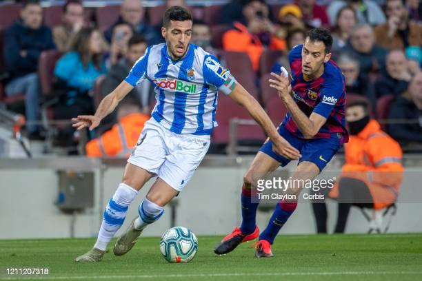 Mikel Merino of Real Sociedad defended by Sergio Busquets of Barcelona during the Barcelona V Real Sociedad La Liga regular season match at Estadio...