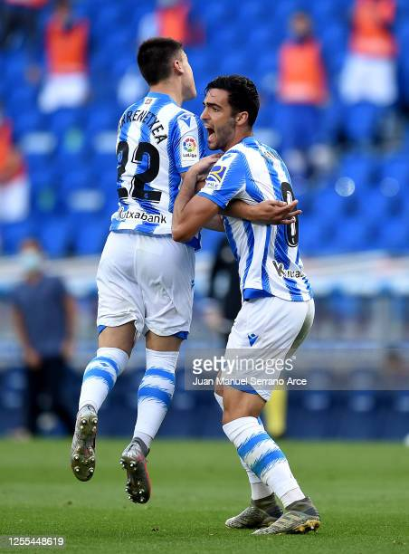 Mikel Merino of Real Sociedad is congratulated by Ander Barrenetxea of Real Sociedad after he scores his teams first goal during the Liga match...