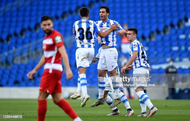Mikel Merino of Real Sociedad is congratulated by Martin Zubimendi of Real Sociedad after he scores his teams first goal during the Liga match...