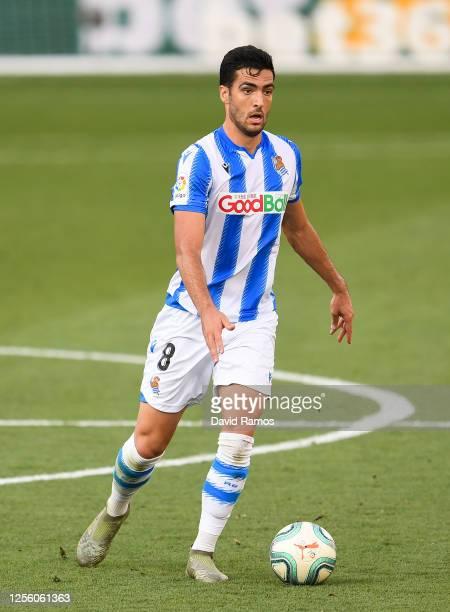 Mikel Merino of Real Sociedad runs with the ball during the Liga match between Villarreal CF and Real Sociedad at Estadio de la Ceramica on July 13,...