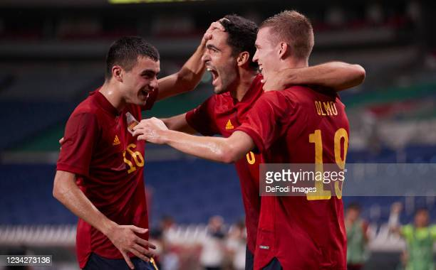 Mikel Merino of Spain celebrates after scoring his team's first goal with Dani Olmo of Spain and Pedri Gonzales of Spain during the Men's Group C...