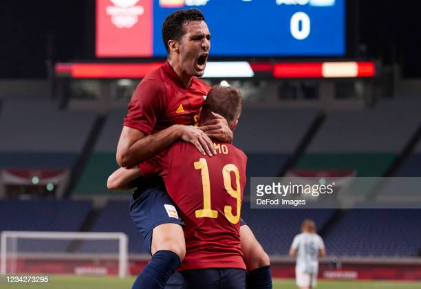 Mikel Merino of Spain celebrates after scoring his team's first goal with Dani Olmo of Spain during the Men's Group C match between Spain and...