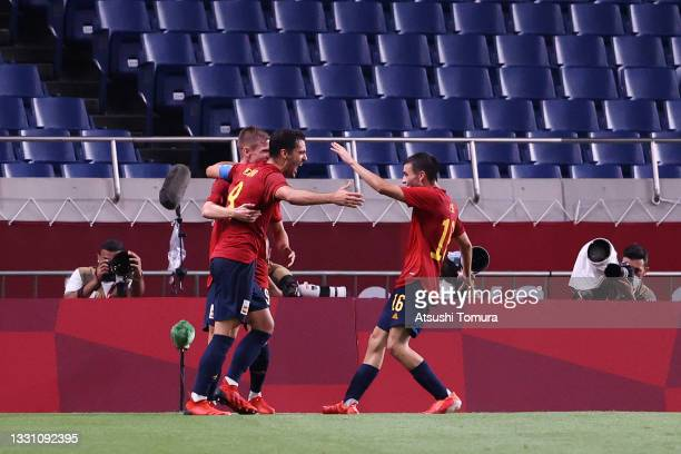 Mikel Merino of Team Spain celebrates with Pedri Gonzalez after scoring their side's first goal during the Men's First Round Group C match between...