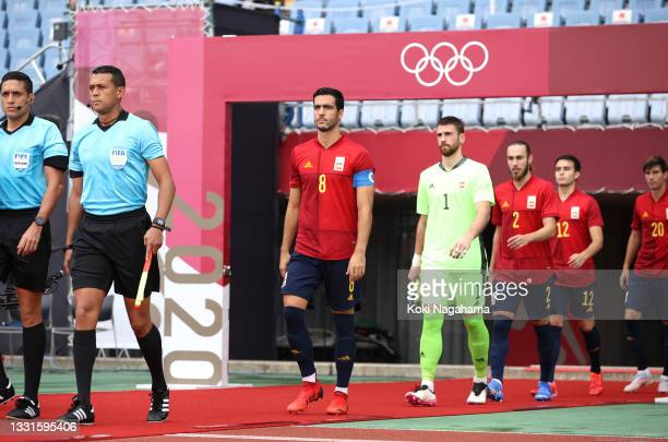 Mikel Merino of Team Spain leads the team on to the pitch prior to the Men's Quarter Final match between Spain and Cote d'Ivoire on day eight of the...