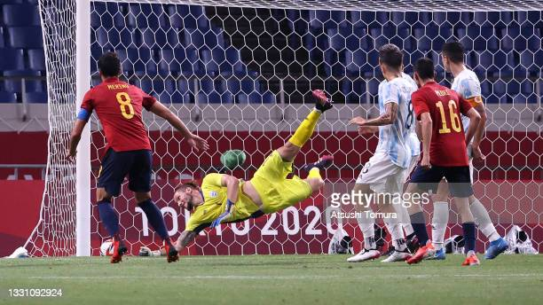 Mikel Merino of Team Spain scores their side's first goal past Jeremias Ledesma of Team Argentina during the Men's First Round Group C match between...