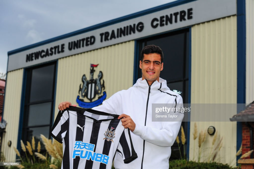 Mikel Merino poses for a photograph holding a home shirt after signing a permanent contract at the Newcastle United Training Centre on October 13, 2017, in Newcastle, England.