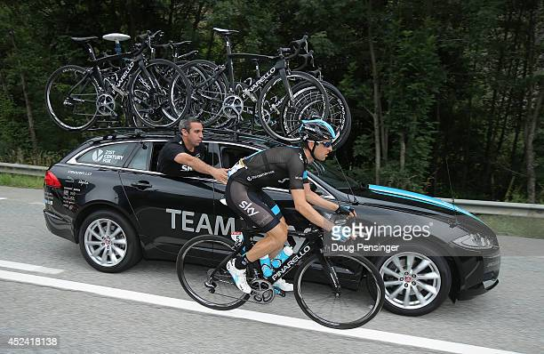 Mikel Nieve Ituralde of Spain and Team Sky receives service from the team car as he rides in the breakaway during the fourteenth stage of the 2014...