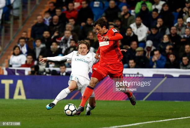 Mikel Oyarzabal and Modric competes for the ball with of during the match Feb 2018 Madrid Spain Real Madrid and Real Sociedad at Estadio Santiago...