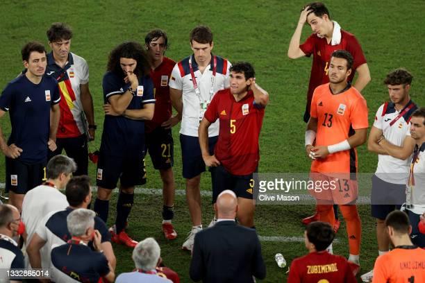 Mikel Oyarzabal, Marc Cucurella, Jesus Vallejo and Alvaro Fernandez of Team Spain look dejected following defeat in the Men's Gold Medal Match...