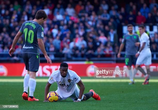 Mikel Oyarzabal midfielder of Real Sociedad and Geoffrey Kondogbia midfielder of Valencia CF looks during the La Liga match between Valencia CF and...