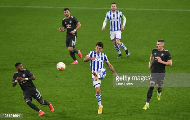 Mikel Oyarzabal of Real Sociedad and Fred of Manchester United and Scott McTominay of Manchester United during the UEFA Europa League Round of 32...