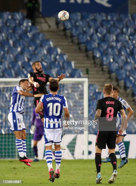 Mikel Oyarzabal of Real Sociedad Ander Guevara of Real Sociedad and Karim Benzema of Real Madrid battle for the ball during the La Liga Santader...