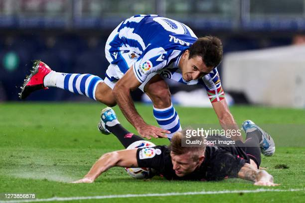 Mikel Oyarzabal of Real Sociedad battle for the ball with Toni Kroos of Real Madrid during the La Liga Santader match between Real Sociedad and Real...