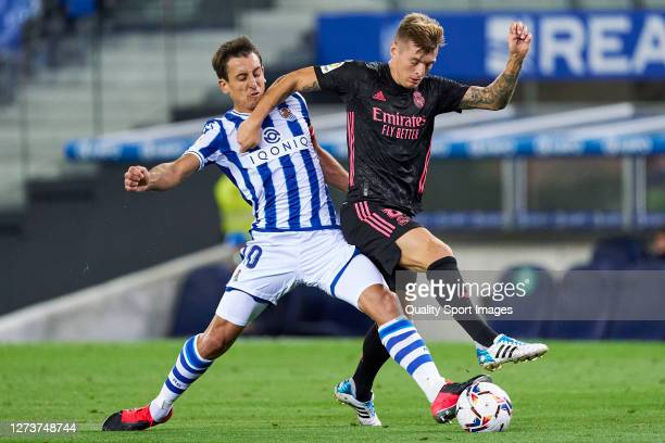 Mikel Oyarzabal of Real Sociedad battles for the ball with Toni Kroos of Real Madrid during the La Liga Santader match between Real Sociedad and Real...