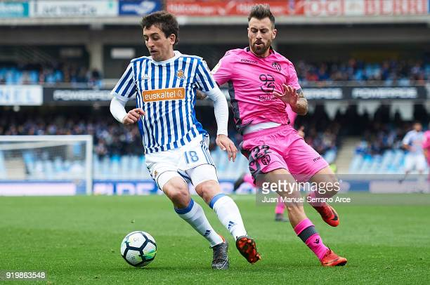 Mikel Oyarzabal of Real Sociedad being followed by Antonio Luna of Levante UD during the La Liga match between Real Sociedad and Levante at Estadio...