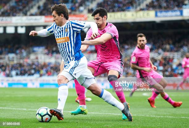 Mikel Oyarzabal of Real Sociedad being followed by Jose Manuel Rodriguez 'Chema' of Levante UD during the La Liga match between Real Sociedad and...