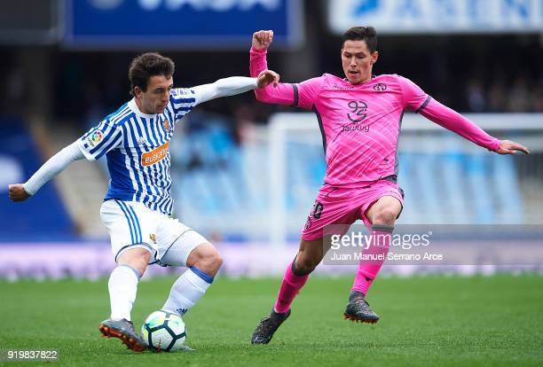 Mikel Oyarzabal of Real Sociedad being followed by Sasa Lukic of Levante UD during the La Liga match between Real Sociedad and Levante at Estadio de...