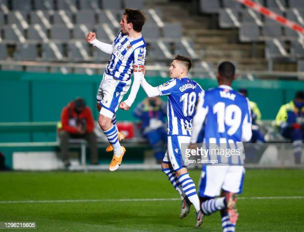 Mikel Oyarzabal of Real Sociedad celebrates with teammate Andoni Gorosabel after scoring their team's first goal during the Supercopa de Espana Semi...