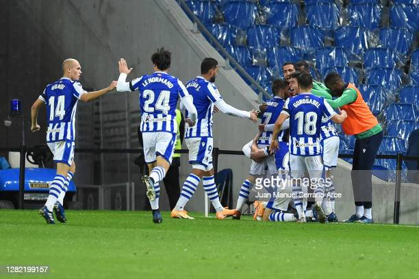 Mikel Oyarzabal of Real Sociedad celebrates with teammates after scoring his team's second goal during the La Liga Santander match between Real...