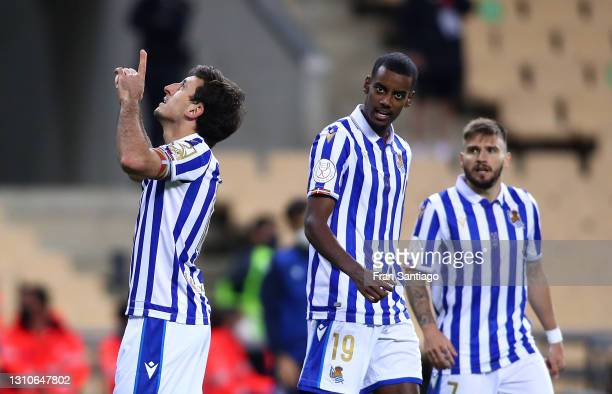 Mikel Oyarzabal of Real Sociedad celebrates with teammates Alexander Isak and Portu after scoring their team's first goal during the Copa Del Rey...
