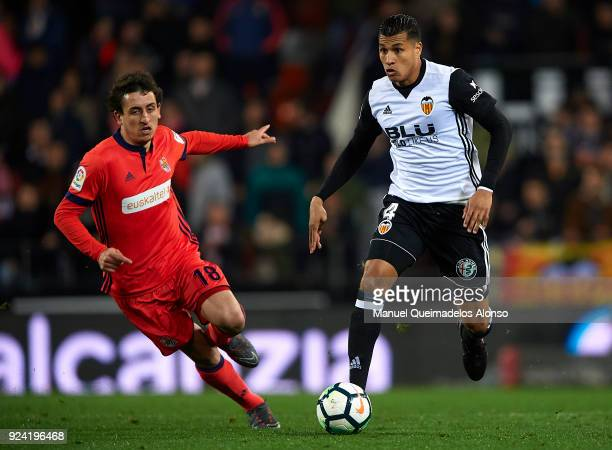 Mikel Oyarzabal of Real Sociedad chases down Jeison Murillo of Valencia during the La Liga match between Valencia CF and Real Sociedad at Mestalla...
