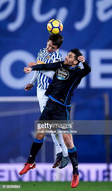 Mikel Oyarzabal of Real Sociedad duels for the ball with Eneko Boveda of RC Deportivo La Coruna during the La Liga match between Real Sociedad de...