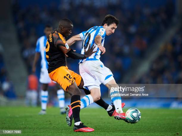 Mikel Oyarzabal of Real Sociedad duels for the ball with Mouctar Diakhaby of Valencia CF during the Liga match between Real Sociedad and Valencia CF...