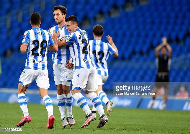 Mikel Oyarzabal of Real Sociedad is congratulated after he scores his side second goal during the Liga match between Real Sociedad and Granada CF at...
