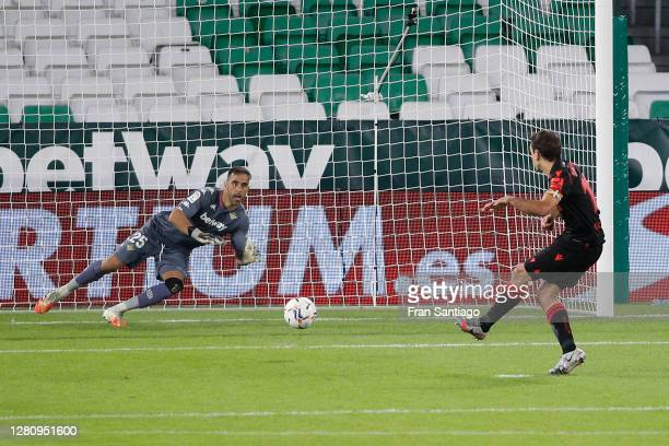 Mikel Oyarzabal of Real Sociedad scores his team's second goal from the penalty spot during the La Liga Santander match between Real Betis and Real...