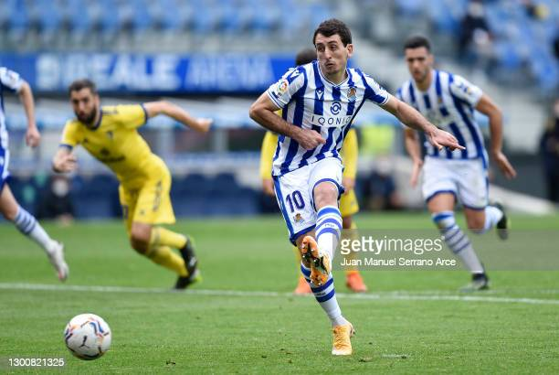 Mikel Oyarzabal of Real Sociedad scores their side's first goal from the penalty spot during the La Liga Santander match between Real Sociedad and...