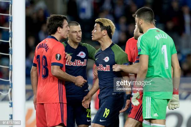 Mikel Oyarzabal of Real Sociedad Stefan Lainer of Red Bull Salzburg HeeChan Hwang of Red Bull Salzburg Geronimo Rulli of Real Sociedad during the...