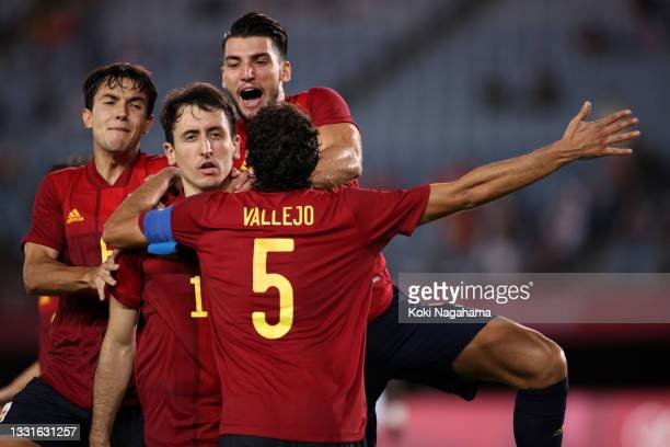 Mikel Oyarzabal of Team Spain celebrates with his team mate after scoring their side's third goal from the penalty spot during the Men's Quarter...