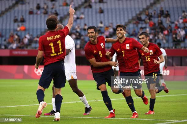 Mikel Oyarzabal of Team Spain celebrates with teammates Mikel Merino and Marco Asensio after scoring a goal that is later disallowed by VAR during...