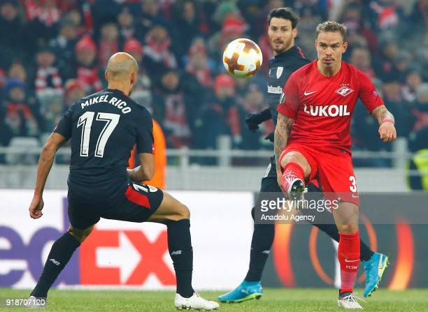 Mikel Rico of Athletic Bilbao and Andrey Escenko Spartak Moscow vie for the ball during the UEFA Europa League round of 32 first leg soccer match...