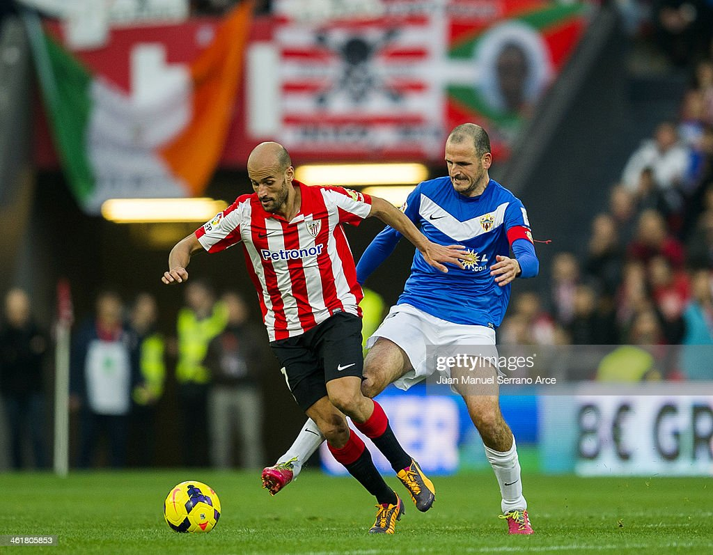 Mikel Rico of Athletic Club Bilbao competes for the ball with Fernando Soriano of UD Almeria during the La Liga match between Athletic Club Bilbao andÊUD AlmeriaÊat San Mames Stadium on January 11, 2014 in Bilbao, Spain.