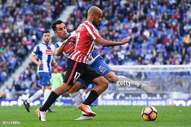 Mikel Rico of Athletic Club competes for the ball with Jose Manuel Jurado of RCD Espanyol during the La Liga match between RCD Espanyol and Athletic...