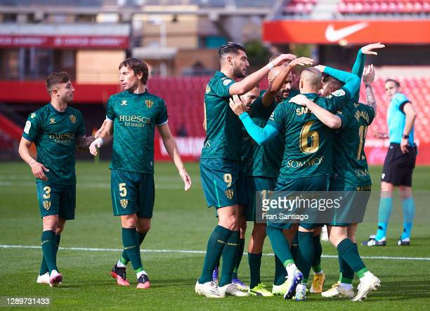Mikel Rico of SD Huesca celebrates scoring his team's opening goal with team mates during the La Liga Santander match between Granada CF and SD...