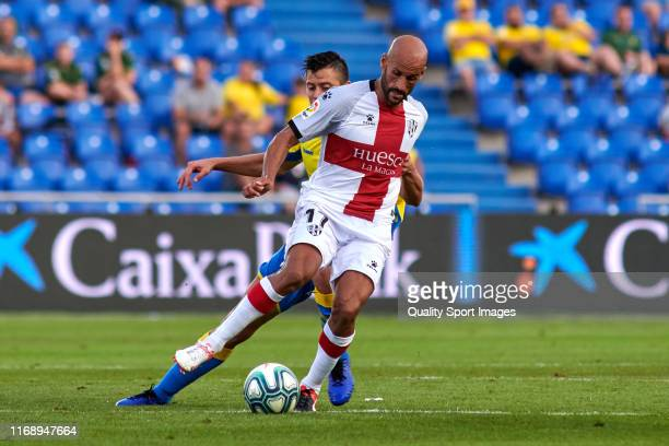 Mikel Rico of SD Huesca competes for the ball with Martin Mantovani of Las Palmas during the La Liga Smartbank match between Las Palmas and SD Huesca...