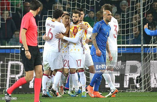Mikel San Jose Aritz Aduriz and Nacho of Spain celebrate a goal during the international friendly match between Italy and Spain at Stadio Friuli on...