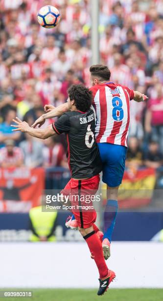 Mikel San Jose Dominguez of Athletic Club fights for the ball with Saul Niguez Esclapez of Atletico de Madrid during the La Liga match between...