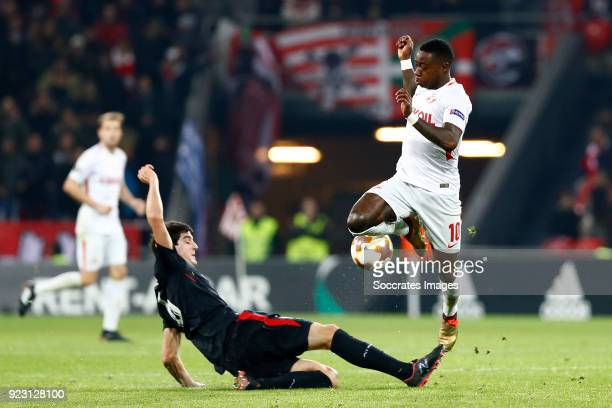 Mikel San Jose of Athletic Bilbao Quincy Promes of Spartak Moscow during the UEFA Europa League match between Athletic de Bilbao v Spartak Moscow at...