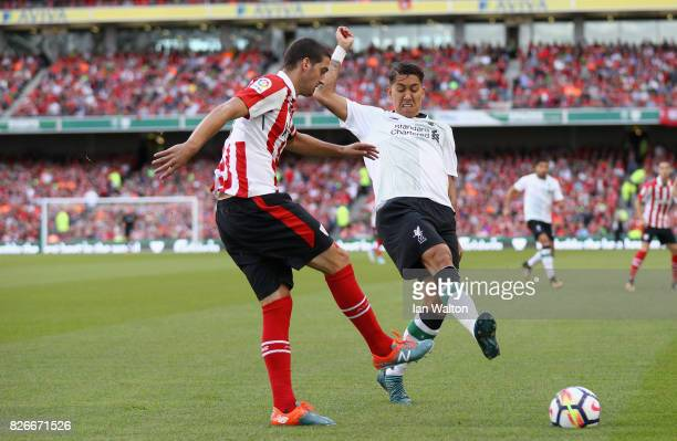 Mikel San Jose of Athletic Club and Roberto Firmino of Liverpool battle for possession during the Pre Season Friendly match between Liverpool and...