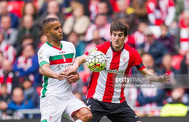 Mikel San Jose of Athletic Club Bilbao competes for the ball with Youssef El Arabi of Granada CF during the La Liga match between Athletic Club...
