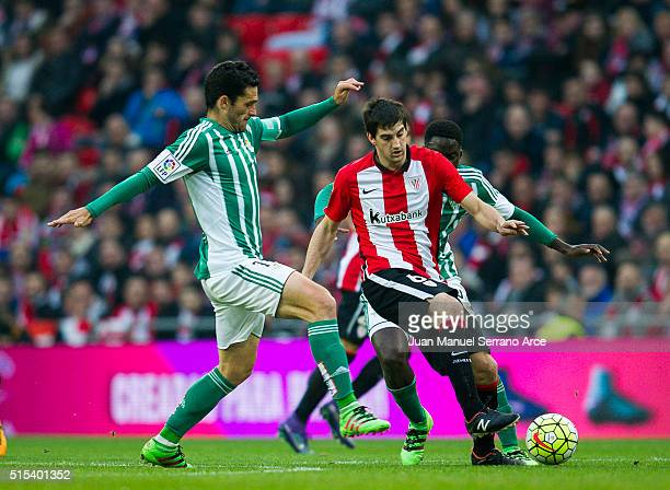 Mikel San Jose of Athletic Club Bilbao competes for the ball with Jorge Molina of Real Betis Balompie during the La Liga match between Athletic Club...
