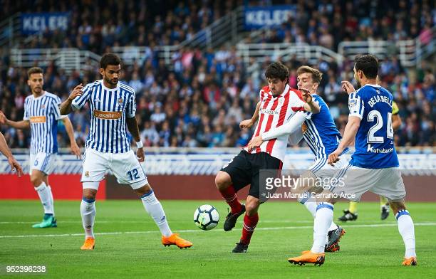 Mikel San Jose of Athletic Club competes for the ball with Diego Llorente of Real Sociedad during the La Liga match between Real Sociedad and...